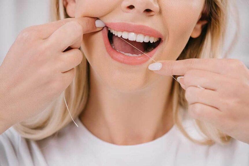 Cómo usar hilo dental - AM Odontología